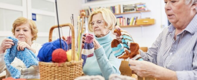 Eldery women crocheting to keep their minds active.